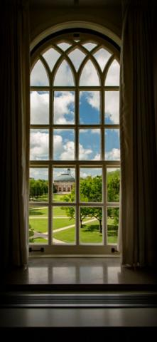 view of the Illinois quad through a paned window