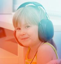 smiling 5-year-old-boy wearing headphones