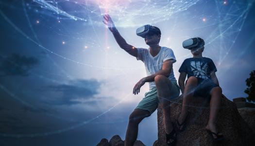 Man and boy using VR headset