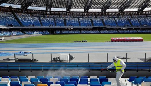 Worker clears debris from empty stadium