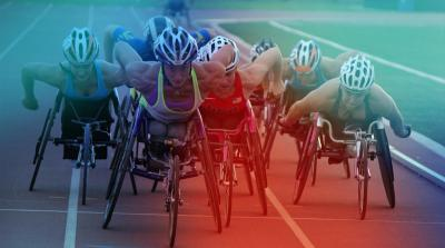7 wheelchair racers in the middle of a race